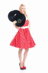 Arrogante Frau hält Schallplatten