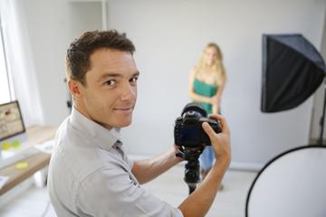 Fashion photographer at work in studio