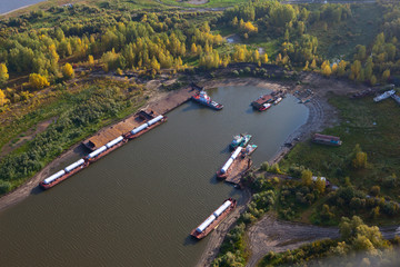 barges with gasoline tanks on the river bay, top view