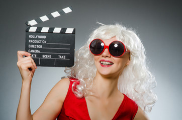 Blond woman with movie board