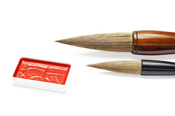 asian writing brushes and ink for calligraphy isolated on white