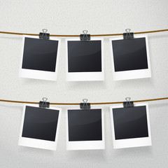blank photo frames on rope