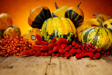 Decorative pumpkins on old wooden table