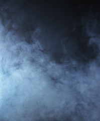 Light blue smoke on a black background