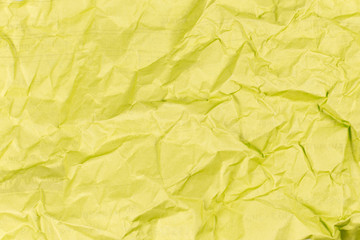 yellow crumpled paper texture background.