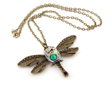 Steampunk dragonfly pendant on white background