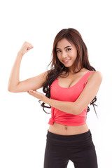 young sporty woman showing, checking her biceps arm muscle