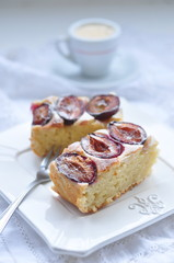 Plum cake with coffee, selective focus