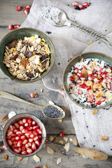 pomegranate grains and bowl of yogurt with seed and muesli