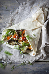 flatbread roll with grilled eggplants tomatoes, herb and yogurt