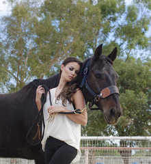 Beautiful young woman and her horse