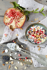 pomegranate and white yogurt with grains and almonds