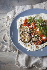 flatbread with grilled eggplants tomatoes fennel herb and yogurt