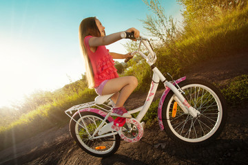 Wall Murals Cycling Happy little girl riding a bicycle