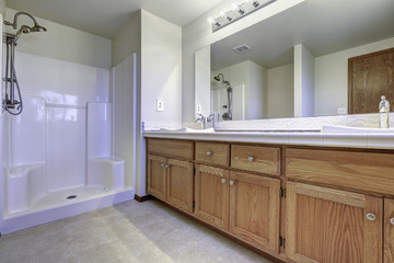 Spacious bathroom interior with open shower