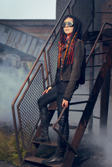 Young woman in industrial style standing on stairs
