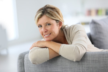 Beautiful 40-year-old woman relaxing in sofa