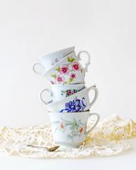 Stack of vintage tea cups for high tea