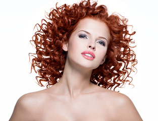 Beautiful young woman with red curly hair.