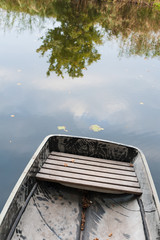 one boat on autumn water of pond