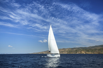 Sailing in the wind through the waves. Yachting. Luxury yachts.