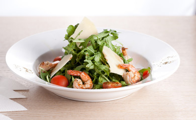 salad with shrimp on white dish and wooden table