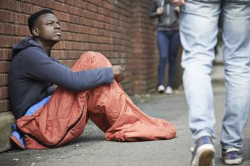 Homeless Teenage Boy BIn Sleeping Bag On The Street