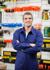 Worker With Arms Crossed In Hardware Store