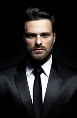 Fashion - handsome man in suit with jacket and tie