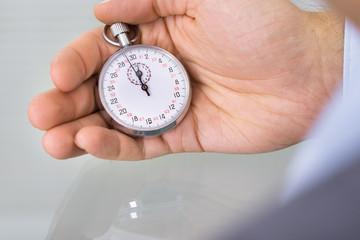 Business advisor holding stopwatch