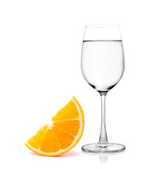 Glass of water and Half orange fruit on white background