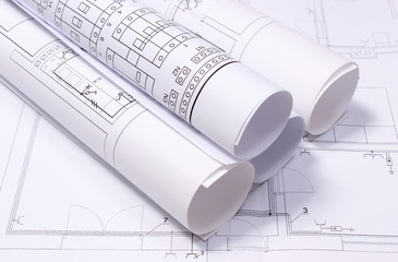 Rolled electrical diagrams on construction drawing of house