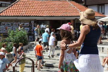 People visit Old Town on August 29, 2014 in Nesebar, Bulgaria