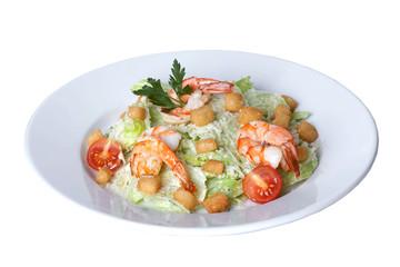 Caesar salad with shrimp on a plate