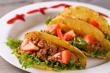 three taco shells on the plate