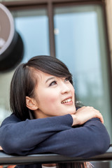 young asian woman at balcony