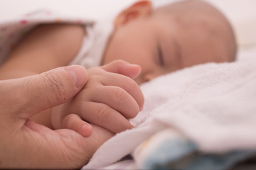 Sleeping Baby Holding Mother Hand