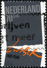 stamp shows Symbolic Separation, Martin Luther