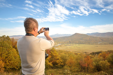 Man photographed on a smartphone
