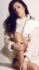 beautiful woman with dark hair in leather fur coat