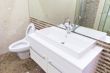 white sink washbasin and silver faucet