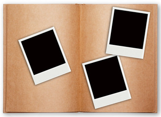 three polaroid frame with old book open