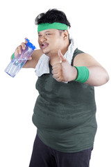 Overweight man drinking water