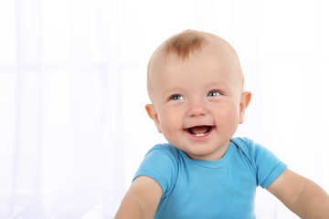 Cute baby boy on light background