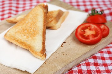Picnic with triangle sandwich toast and fresh tomato