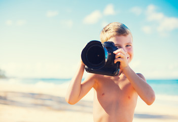 Boy on the Beach with Camera