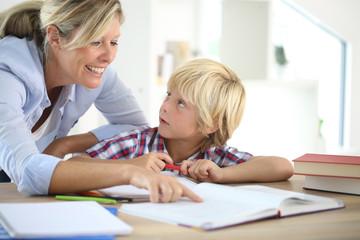 Mom helping little boy to do homework