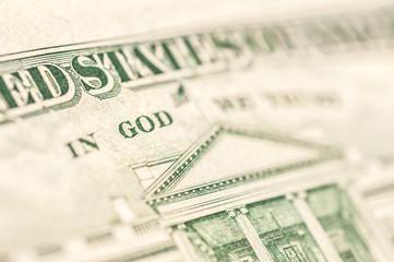 Word GOD in paper money