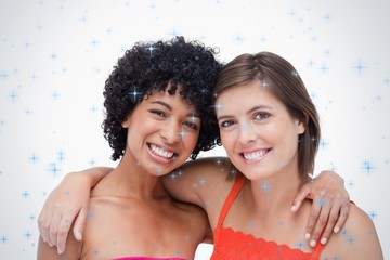 Two smiling friends holding each other by the shoulder