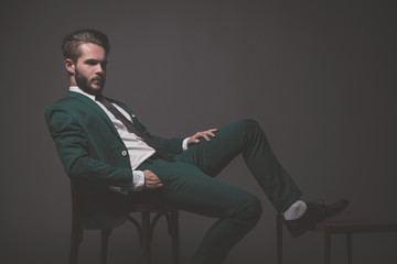 Business fashion man wearing green suit with white shirt black a